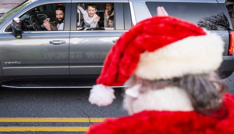 Holiday parade in Winston-Salem has spectators drive the route |